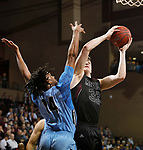 SIOUX FALLS, SD - MARCH 9:  Tyler Borchers #33 of Morningside shoots over De'Jon Bowman #14 of Warner Pacific at the 2018 NAIA DII Men's Basketball Championship at the Sanford Pentagon in Sioux Falls. (Photo by Dick Carlson/Inertia)