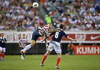 May 26, 2012:   USA Men's National Team m Jermaine Jones (13) leaps to head the ball against Scotland Scott Brown (8) during action between the USA and Scotland at EverBank Field in Jacksonville, Florida.  USA defeated Scotland 5-1.............