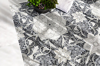 Aurelia, a stone hand-cut mosaic, is shown in Thassos, Afyon White, Allure, Carrara polished.