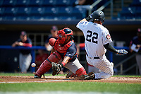 Lowell Spinners catcher Alberto Schmidt (20) waits to receive a throw as Bill Springman (22) slides home during a game against the Staten Island Yankees on August 22, 2018 at Richmond County Bank Ballpark in Staten Island, New York.  Staten Island defeated Lowell 10-4.  (Mike Janes/Four Seam Images)