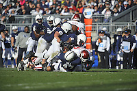 17 November 2012:  Penn State LBs Glenn Carson (40), Gerald Hodges (6) and DT Jordan Hill (47) tackle Indiana RB Isaiah Roundtree (38)  The Penn State Nittany Lions defeated the Indiana Hoosiers 45-22 at Beaver Stadium in State College, PA.