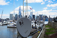 New York, United States. 19th May 2014 - A DirecTV antenna and the World Trade Center are seen at the Morris canal in Jersey City, New Jersey. Photo by Eduardo MunozAlvarez/VIEW