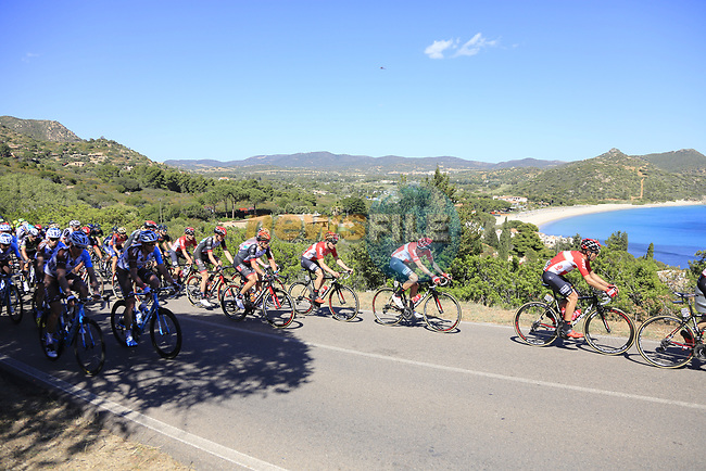 The peloton pass the stunning coastline at Villasimius during Stage 3 of the 100th edition of the Giro d'Italia 2017, running 148km from Tortoli to Cagliari, Sardinia, Italy. 7th May 2017.<br /> Picture: Ann Clarke | Cyclefile<br /> <br /> <br /> All photos usage must carry mandatory copyright credit (&copy; Cyclefile | Ann Clarke)