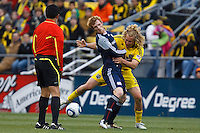 8 MAY 2010:  Referee Ramon Hernandez, New England Revolutions' Pat Phelan (28) and Steven Lenhart of the Columbus Crew (32) during MLS soccer game between New England Revolution vs Columbus Crew at Crew Stadium in Columbus, Ohio on May 8, 2010. The Columbus defeated New England 3-2.