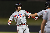 AFL East left fielder Austin Listi (23), of the Scottsdale Scorpions and Philadelphia Phillies organization, is congratulated by Jake Rogers (not pictured) after hitting a go-ahead three-run home run in the eighth inning of the Arizona Fall League Fall Stars game at Surprise Stadium on November 3, 2018 in Surprise, Arizona. The AFL West defeated the AFL East 7-6 . (Zachary Lucy/Four Seam Images)