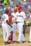 Yu Darvish (Rangers),<br /> JULY 22, 2013 - MLB :<br /> Yu Darvish of the Texas Rangers is pulled by manager Ron Washington (L) in the seventh inning as catcher Geovany Soto and Adrian Beltre look on during the Major League Baseball game against the New York Yankees at Rangers Ballpark in Arlington in Arlington, Texas, United States. (Photo by AFLO)