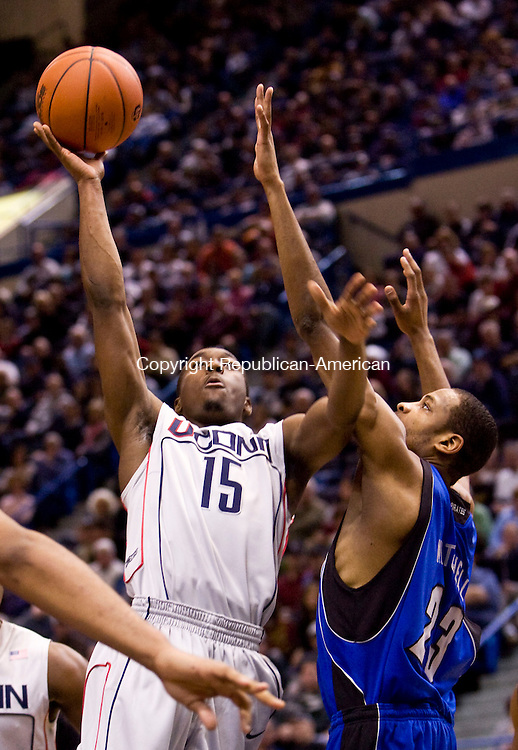 HARTFORD, CT - 18 JANUARY 2009 -011809JT09-<br /> UConn's Kemba Walker tries to make a shot under pressure from Seton Hall's Robert Mitchell during Sunday's game at the XL Center in Hartford. UConn won, 76-61.<br /> Josalee Thrift / Republican-American
