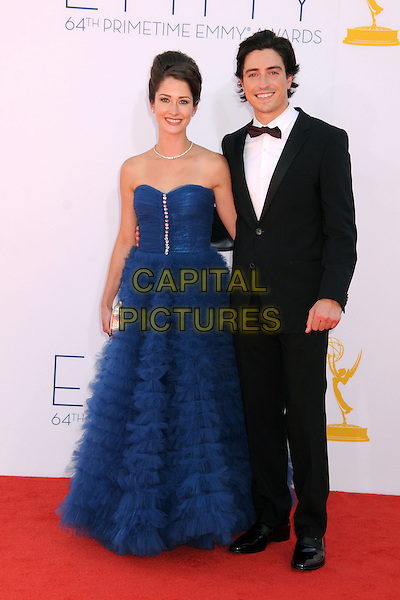 guest & Ben Feldman.The 64th Anual Primetime Emmy Awards - Arrivals, held at Nokia Theatre L.A. Live in Los Angeles, California, USA..September 23rd, 2012.emmys full length blue strapless dress black tuxedo white shirt .CAP/ADM/BP.©Byron Purvis/AdMedia/Capital Pictures.