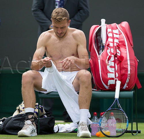 July 4th 2017, All England Lawn Tennis and Croquet Club, London, England; The Wimbledon Tennis Championships, Day 2; Alexander Ward (GBR) changes his shirt during a break in his match against Kyle Edmund (GBR)
