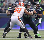 Seattle Seahawks  offensive lineman Patrick Lewis (65) and Justin Britt (68) blocks Cleveland Browns defensive lineman Desmond Bryant (92) as quarterback Russell Wilson (3) looks to pass at CenturyLink Field in Seattle, Washington on December 20, 2015. The Seahawks clinched their fourth straight playoff berth in four seasons by beating the Browns 30-13.  ©2015. Jim Bryant Photo. All Rights Reserved.