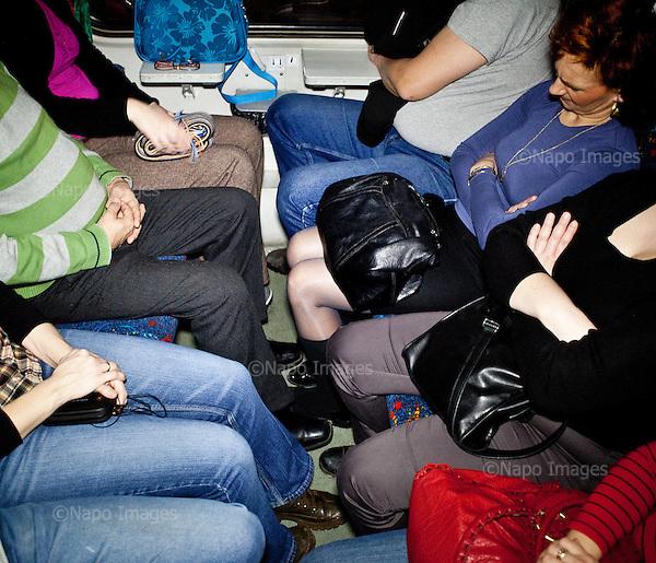 CENTRAL POLAND, FEBRUARY 2012:.Train to Warsaw at 4:50am. About 500 thousand people commute everyday from other towns and villages to work in the Polish capital..(Photo by Piotr Malecki / Napo Images)..Luty 2012:.Pociag do Warszawy o 4:50 rano. Dojezdzajacy z Lodzi, Skierniewic i Zyrardowa przysypiaja wczesnym rankiem w  przedziale. Okolo 500 tysiecy osob dojezdza codziennie z innych miast do pracy w Warszawie.  .Fot: Piotr Malecki / Napo Images