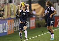 BOCA RATON, FL - DECEMBER 15, 2012: Tobinn Heath (17) of the USA WNT watches Becky Sauerbrunn (4) take a throw in against China WNT during an international friendly match at FAU Stadium, in Boca Raton, Florida, on Saturday, December 15, 2012. USA won 4-1.