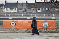 Pictured: A woman walks past a banner advertising the game by river Usk in Newport, Wales, UK. Thursday 14 February 209<br /> Re: The city of Newport is preparing to host the FA Cup match between Newport County and Manchester City at Rodney Parade, Newport, Wales, UK.