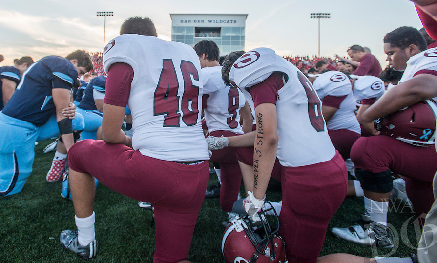 NWA Democrat-Gazette/ANTHONY REYES &bull; @NWATONYR<br /> Springdale Har-Ber and Springdale football teams gather at mid-field Friday, Sept. 30, 2016 for a tribute for Kyler Williams at Wildcat Stadium in Springdale. Williams, a star receiver for Springdale, was killed in a car accident last Saturday.