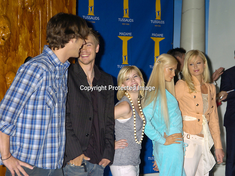 "Jared Padalecki, Chad Michael Murray, Elisha Cuthbert and Paris Hilton and her Wax Figure. left, ..at Madame Tussauds to reveal Paris Hilton's Wax Figure with the Cast of ""House of Wax"" on May 2, 2005 . ..Photo by Robin Platzer, Twin Images"