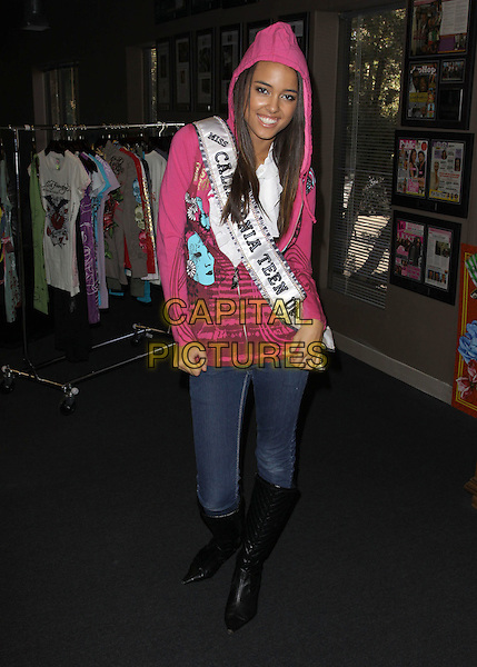 MISS TEEN CALIFORNIA CHELSEA GILLIGAN.Visiting Ed Hardy Headquarters,  Ed Hardy Outlet, Culver City, California, USA, 25th September 2009..full length jeans sash pink hoodie top black knee high boots .CAP/ADM/KB.©Kevan Brooks/AdMedia/Capital Pictures.