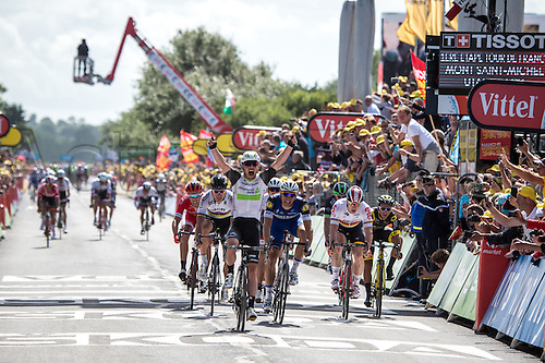 02.07.2016. Normandy, France. Tour de France cycling tour, stage 1 from Utah Beach. Mark Cavendish celebrates as he crosses the line as stage winner and will wear his first ever yellow jersey.