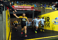 Dane Coles leads his team out for the Super Rugby quarterfinal match between the Hurricanes and Sharks at Westpac Stadium, Wellington, New Zealand on Saturday, 23 July 2016. Photo: Dave Lintott / lintottphoto.co.nz