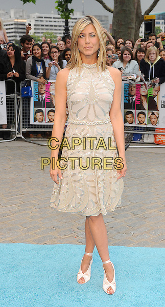 Jennifer Aniston.Horrible Bosses UK Premiere, BFI, London, England..20th July 2011.full length length white cream dress sheer gold folds folded pleats pleated sleeveless braid braided belt sequins sequined ribbon ankle shoes peep toe  .CAP/BEL.©Tom Belcher/Capital Pictures.