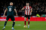 John Egan (r) of Sheffield United runs at Jonjo Shelvey of Newcastle United during the Premier League match at Bramall Lane, Sheffield. Picture date: 5th December 2019. Picture credit should read: James Wilson/Sportimage