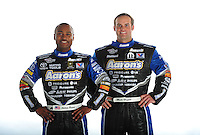 Jan. 8, 2012; Brownsburg, IN, USA; NHRA top fuel dragster driver Antron Brown (left) and funny car driver Matt Hagan pose for a portrait during a photo shoot at the Don Schumacher Racing shop. Mandatory Credit: Mark J. Rebilas-