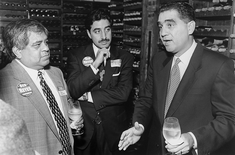 Gene Green challenger Ben Reyes (right) at his fundraiser in a wine cellar. (Photo by Chris Martin/CQ Roll Call)