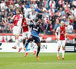 Nederland, Amsterdam, 30 maart 2014<br /> Eredivisie<br /> Seizoen 2013-2014<br /> Ajax-FC Twente<br /> Daley Blind (l.) van Ajax, Stefano Denswil (2e van l.) en Quincy Promes (2e van r.) van FC Twente strijden in een kopduel om de bal.