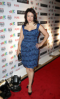 JENNIFER TILLY.The Ante Up for Africa Celebrity Poker Tournament at the Rio Resort Hotel and Casino, Las Vegas, Nevada, USA..July 2nd, 2009.full length blue black dress hand on hip pattern .CAP/ADM/MJT.© MJT/AdMedia/Capital Pictures
