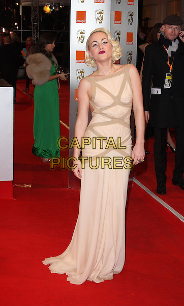 JAMIE WINSTONE.Arrivals at the British Academy Film Awards 2010 at the Royal Opera House, Covent Garden, London, England..February 21st, 2009 .BAFTA BAFTAs full length beige sleeveless maxi dress brown peach beige.CAP/ROS.©Steve Ross/Capital Pictures.