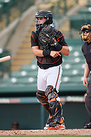 GCL Orioles catcher Jose Montanez (31) throws the ball around after a strikeout, as home plate umpire Kenny Jackson looks on during the first game of a doubleheader against the GCL Twins on August 1, 2018 at CenturyLink Sports Complex Fields in Fort Myers, Florida.  GCL Twins defeated GCL Orioles 7-6 in the completion of a suspended game originally started on July 31st, 2018.  (Mike Janes/Four Seam Images)