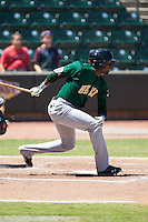 LeVon Washington (8) of the Lynchburg Hillcats follows through on his swing against the Winston-Salem Dash at BB&T Ballpark on August 2, 2015 in Winston-Salem, North Carolina.  The Hillcats defeated the Dash 8-3.  (Brian Westerholt/Four Seam Images)