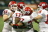 January 5th, 2008:  Rutgers Ray Rice (27) is hugged by teammates Pedro Sosa (77), Ryan Blaszczyk (61) and Mike Teel (14) after scoring a one yard touchdown during the second quarter of the International Bowl at the Rogers Centre in Toronto, Ontario Canada...Rutgers defeated Ball State 52-30.  ..Photo By:  Mike Janes Photography