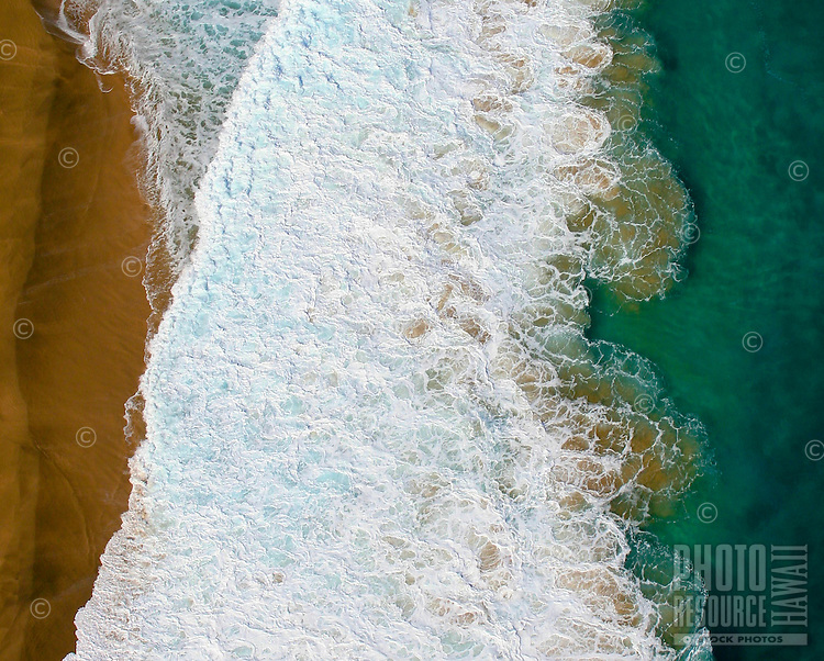 Aerial view of turbulent surf of Na Pali Coast of Kauai.
