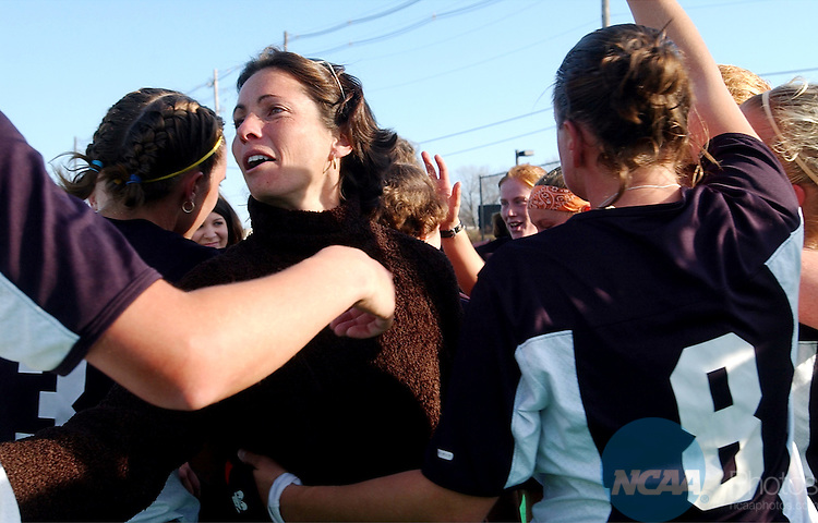 24 NOV 2002:  Wake Forest Head Coach Jennifer Averill celebrates with her team after defeating Penn State during the Division I Women's Field Hockey Championship held at Trager Stadium on the University of Louisville campus in Louisville, KY.   Wake Forest won 2-0 for the national title.  Bill Luster/NCAA Photos