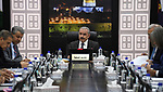 Palestinian Prime Minister Mohammad Ishtayeh, chairs the weekly meeting of his government, in the West Bank city of Ramallah, June 10, 2019. Photo by Prime Minister Office