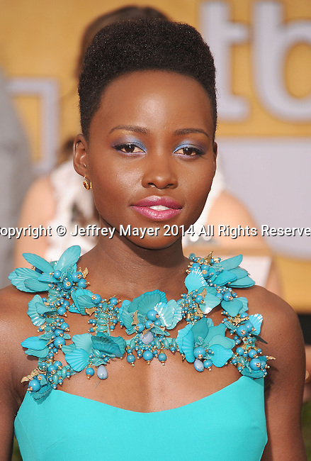 LOS ANGELES, CA- JANUARY 18: Actress Lupita Nyong'o arrives at the 20th Annual Screen Actors Guild Awards at The Shrine Auditorium on January 18, 2014 in Los Angeles, California.