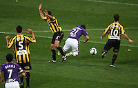 Phoenix' Manny Muscat fouls Mile Sterjovski outside the box during the A-League football match between Wellington Phoenix and Perth Glory at Westpac Stadium, Wellington, New Zealand on Sunday, 16 August 2009. Photo: Dave Lintott / lintottphoto.co.nz