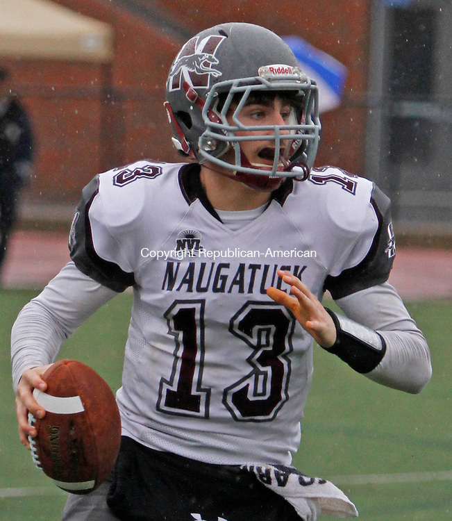 Darien, CT-120614MK08 (ACTIONMAN) Naugatuck's Jason Bradley (13) looks to throw during the CIAC Class L Large semi-final game at Darien High School Saturday afternoon. Darien defeated Naugatuck 42-12. Michael Kabelka / Republican-American