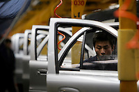 Workers operating on the assembly line of Geely Automobile Holdings LTD in Ningbo, China. Along with other auto makers in China, Geely is now looking overseas to sell its vehicles as stock increases and domestic margine declines. China is currently the world's 4th largest auto maker, plans to boost vehicle and automobile components exports by 15 folds to more than 120 billion yuan (15 billion US) in the next 10 years..18 Jan 2006