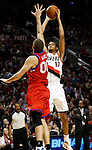 12/26/11--Trail Blazers forward LaMarcus Aldridge takes a jumpshot over 76ers' Spencer Hawes at the Rose Garden...Photo by Jaime Valdez. .... .........................................