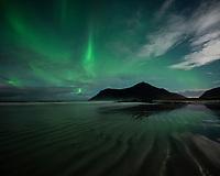 Northern lights fill sky over Skagsanden beach, Flakstadøy, Lofoten Islands, Norway