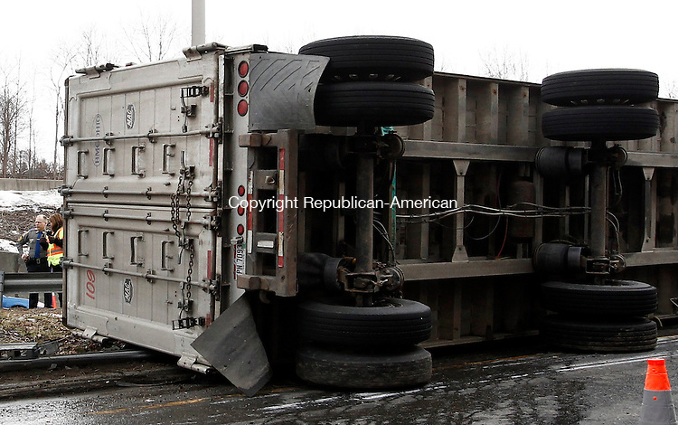 Waterbury, CT- 28 February 2013-022813CM01-  A tractor trailer is overturned on the onramp going onto Interstate 84 from Rt 8 in Waterbury Thursday afternoon.  The crash which happened around noon, is still under investigation.   Christopher Massa Republican-American