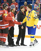 Benjamin Antonietti (Switzerland - 16), Lukas Stoop (Switzerland - 7), Anton Lander (Sweden - 16) - Team Sweden celebrates after defeating Team Switzerland 11-4 to win the bronze medal in the 2010 World Juniors tournament on Tuesday, January 5, 2010, at the Credit Union Centre in Saskatoon, Saskatchewan.