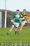 St Brendans Conor Daly tries to juggle the.ball away from the grasp of Avondhu.defender Richard Willis in their Duhallow.Invitation Cup semi-final on Saturday.