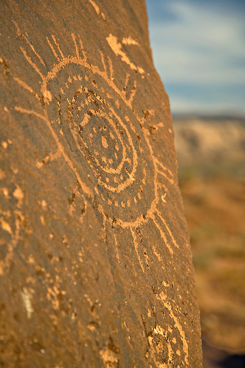 Petroglyphs from at least 3 different prehistoric cultures cover giant fallen boulders at the Little Black Mountain Petroglyph Site