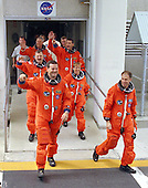 The STS-90 flight crew depart the Operations and Checkout Building at Cape Canaveral Florida on April 17, 1998 on their way to Pad 39B for launch aboard the Space Shuttle Columbia  today for the Neurolab mission. The seven member crew include (front to back, right to left) Mission Commander Richard Searfoss; Pilot Scott Altman; Mission Specialists Kathryn (Kay) Hire, Dafydd (Dave) Williams, M.D., with the Canadian Space Agency, and Richard Linnehan, D.V.M.; and Payload Specialists James Pawelczyk, Ph.D., and Jay Buckey, M.D.<br /> Credit: NASA / CNP