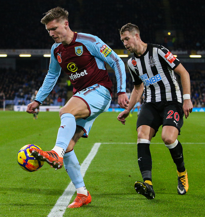 Burnley's Jeff Hendrick controls a ball under pressure from Newcastle United's Florian Lejeune <br /> <br /> Photographer Alex Dodd/CameraSport<br /> <br /> The Premier League - Burnley v Newcastle United - Monday 30th October 2017 - Turf Moor - Burnley<br /> <br /> World Copyright &copy; 2017 CameraSport. All rights reserved. 43 Linden Ave. Countesthorpe. Leicester. England. LE8 5PG - Tel: +44 (0) 116 277 4147 - admin@camerasport.com - www.camerasport.com
