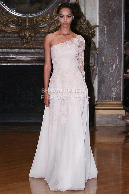 Model walks runway in a bridal gown from the Karen Sabag 2015 Bridal Collection, at Burden Mansion during New York Bridal Fashion Week Spring 2015.
