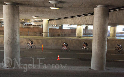 25 AUG 2013 - STOCKHOLM, SWE - Competitors race under a railway bridge during the bike of the Stockholm Triathlon in Stockholm, Sweden (PHOTO COPYRIGHT © 2013 NIGEL FARROW, ALL RIGHTS RESERVED)