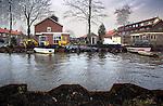 WILNIS - Herstelwerkzaamheden na het doorbreken van de dijkwand waardoor woningen onder water kwamen te liggen. COPYRIGHT TON BORSBOOM